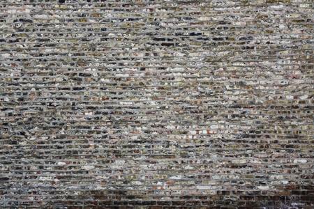 edad de piedra: Fondo urbano (pared de ladrillos)