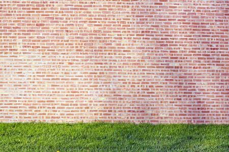 Urban Design - Red Brick Wall with Grass Stock fotó