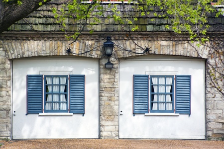 Classic European Garage with blue shutters Stock Photo - 9771648