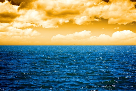 Deep Ocean with cloudy color sky  Stock Photo