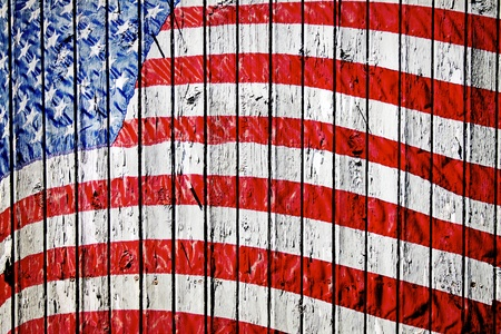 Old Painted American Flag on Dark Wooden Fence Stock Photo - 9888868