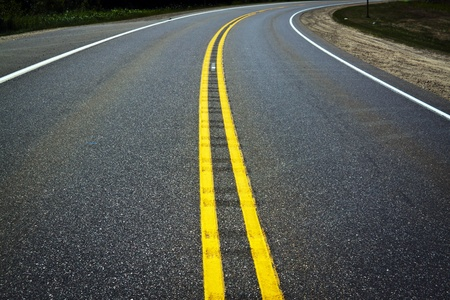 gravel roads: Asphalt Background with yellow stripes