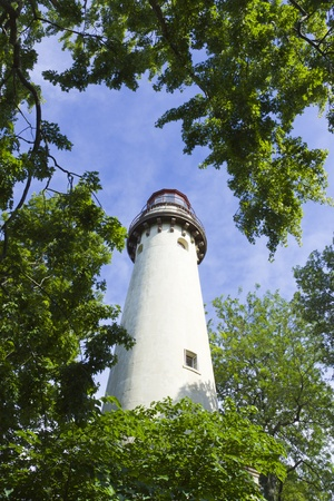 Tall White Lighthouse With Blue Sky photo