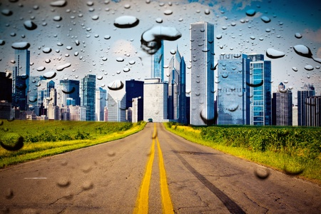 American Country Road with City on the Horizont photo