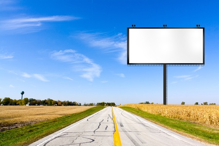 advertise: Billboard on Country Road  Stock Photo