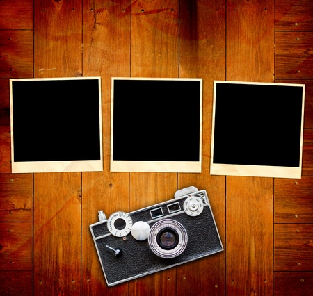 Vintage Pictures and Camera on Wooden Old Table photo