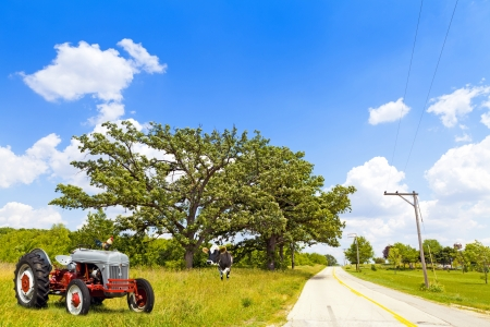 old tractors: Country Road Stock Photo