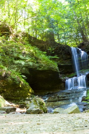 Waterfall in green forest, Michigan USA photo
