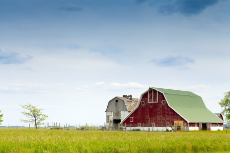 Red Farm With Cloudy Rainy Sky