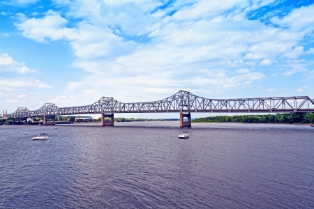 illinois river: long metal bridge with cloudy sky Stock Photo