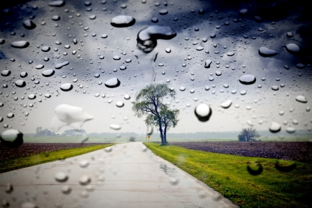 storm background: Country Road in the rain