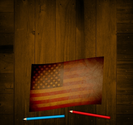 Old Paper on Wooden Table with 4th of july draw photo