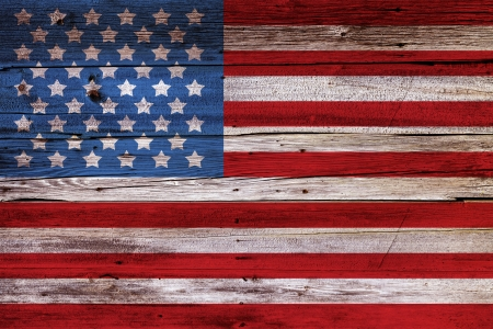 Old Painted American Flag on Dark Wooden Fence  Imagens