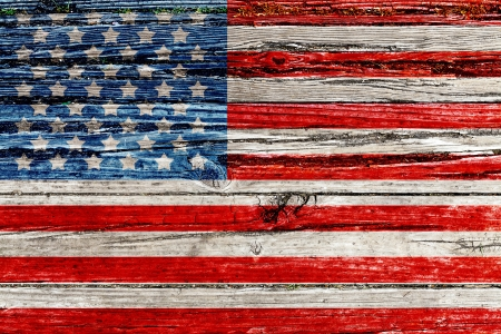 painted wood: Old Painted American Flag on Dark Wooden Fence  Stock Photo