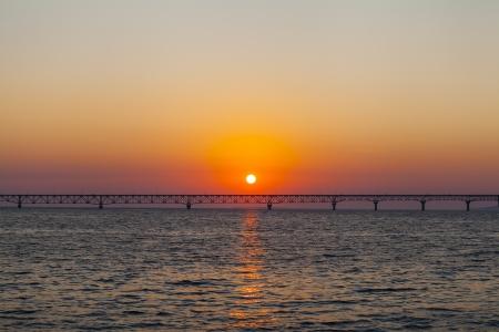 Long Bridge On Summer Sunset Standard-Bild