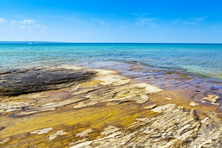 pictured: Carved in rocks naturally beautiful beach in Upper Peninsula Stock Photo