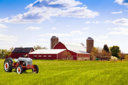 iowa: Traditional american red farm with tractor