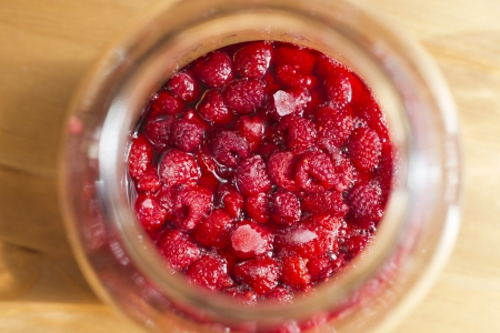 raspberries in jar photo