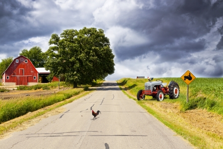 road surface: Country Road With Red Barn and Tractor On Side