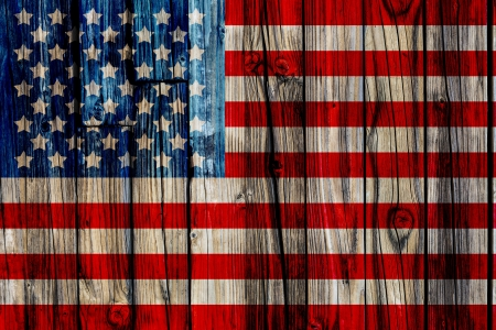 Old Painted American Flag on Dark Wooden Fence  photo