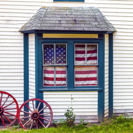 Old House With American Flag in Window