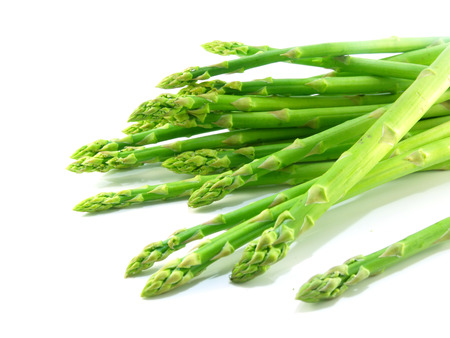 green raw asparagus isolated on white background