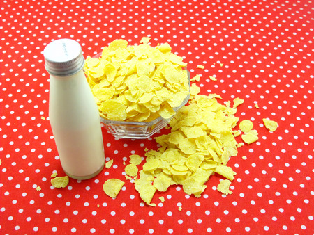 polka dot fabric: cornflakes and youghurt on red polka dot fabric