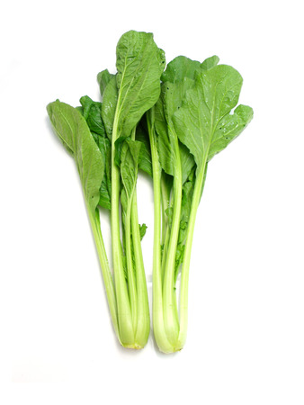 ve: choy sum vegetable pile close up on white background Stock Photo