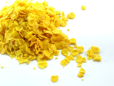 heaped: Crispy Gold cornflakes heaped isolated on a white background Stock Photo