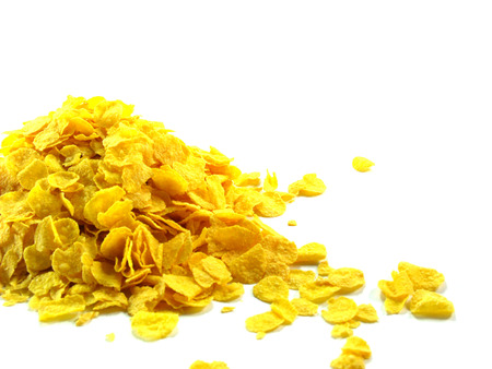 heaped: Ccrispy Gold cornflakes heaped isolated on a white background