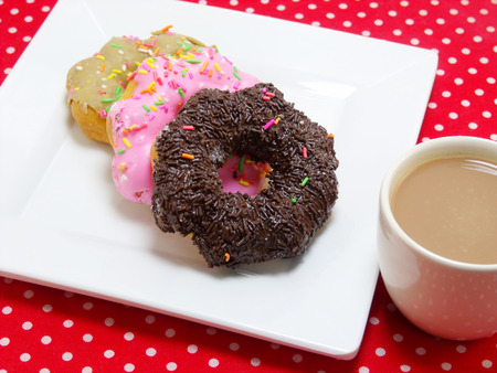 red tablecloth: donut and milk coffee on red tablecloth