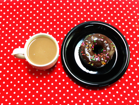 red tablecloth: donut chocolate and milk coffee on red tablecloth