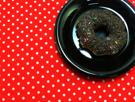 red tablecloth: donut chocolate on red tablecloth