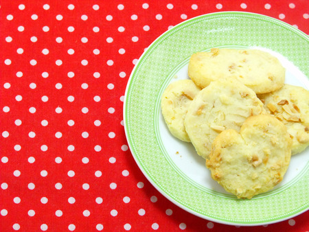 polka dot fabric: butter cookie on red polka dot fabric Stock Photo