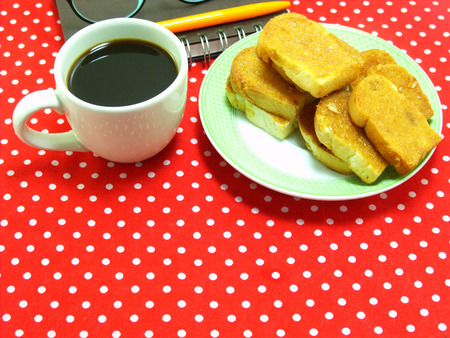 polka dot fabric: coffee time with garlic bread on red polka dot fabric