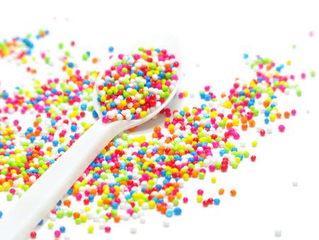 globule: colorful sugar pearls in white spoon