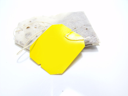 teabag: teabag with yellow label isolated on white background