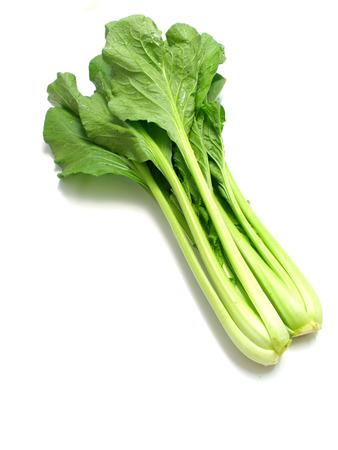 choy sum vegetable pile close up on white background Banco de Imagens