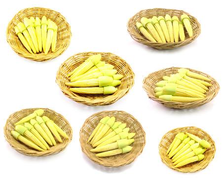 baby corn: baby corn on wooden basket on white background
