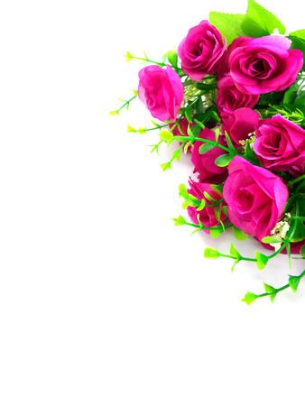 fake: fake pink rose on white background