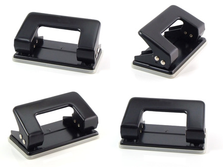 hole punch: black hole punch paper on a white background Stock Photo