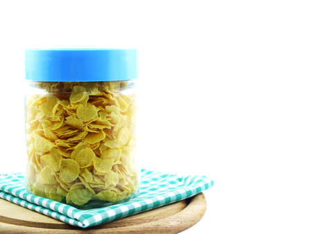 contain: cornflakes in glass contain on white background Stock Photo