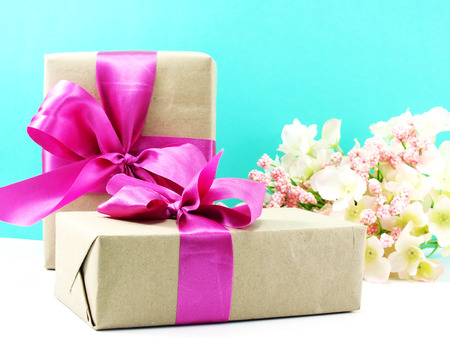 christmas present box: wrapped vintage gift box with pink ribbon bow and rose flower Stock Photo