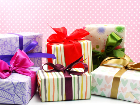 birthday presents: colored gift boxes with decorative bows isolated on white background