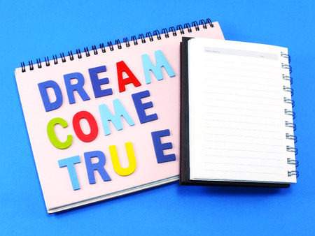come on: stock photo dream come true concept on notebook background