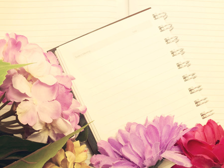 bouqet: note book diary and beautiful flower bouqet with vintage filter instragram effect;