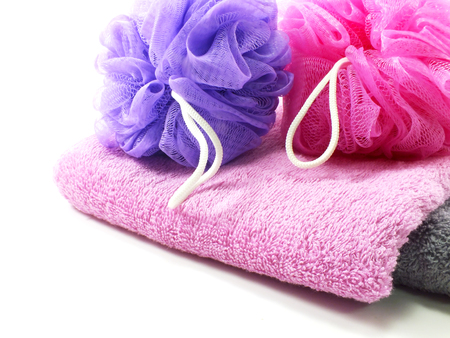 bath: plastic bath puff and towel on white background