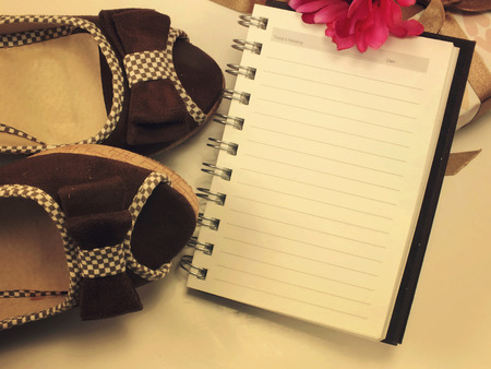 blank paper note book and pair of wman shoes filter vintage retro filter