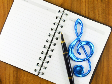 notation: colorful music notation on notebook with pen musical notationcolorful music notation on notebook with pen musical notation Stock Photo