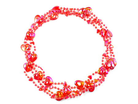 scattered in heart shaped: heart shaped beads on string on white background